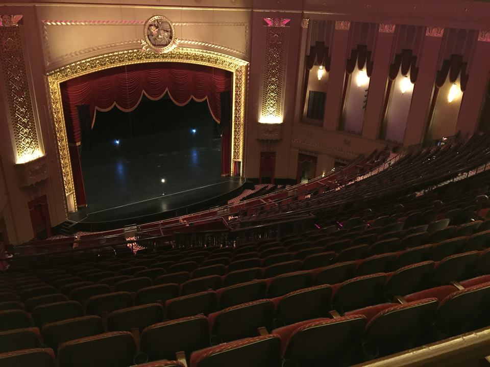A view of an empty stage and auditorium at the Peabody Opera House as seen from above