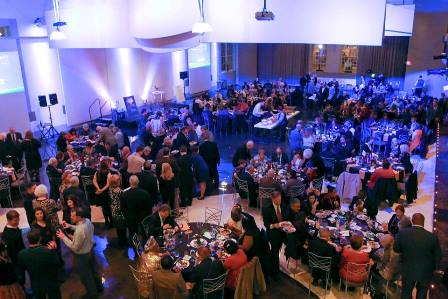 View of the room full of partiers as seen from above